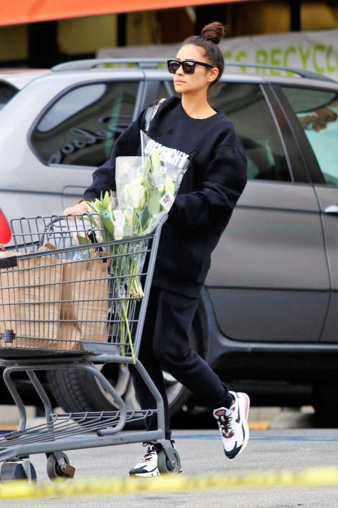 Shay Mitchell in a Black Ripped Sweatshirt
