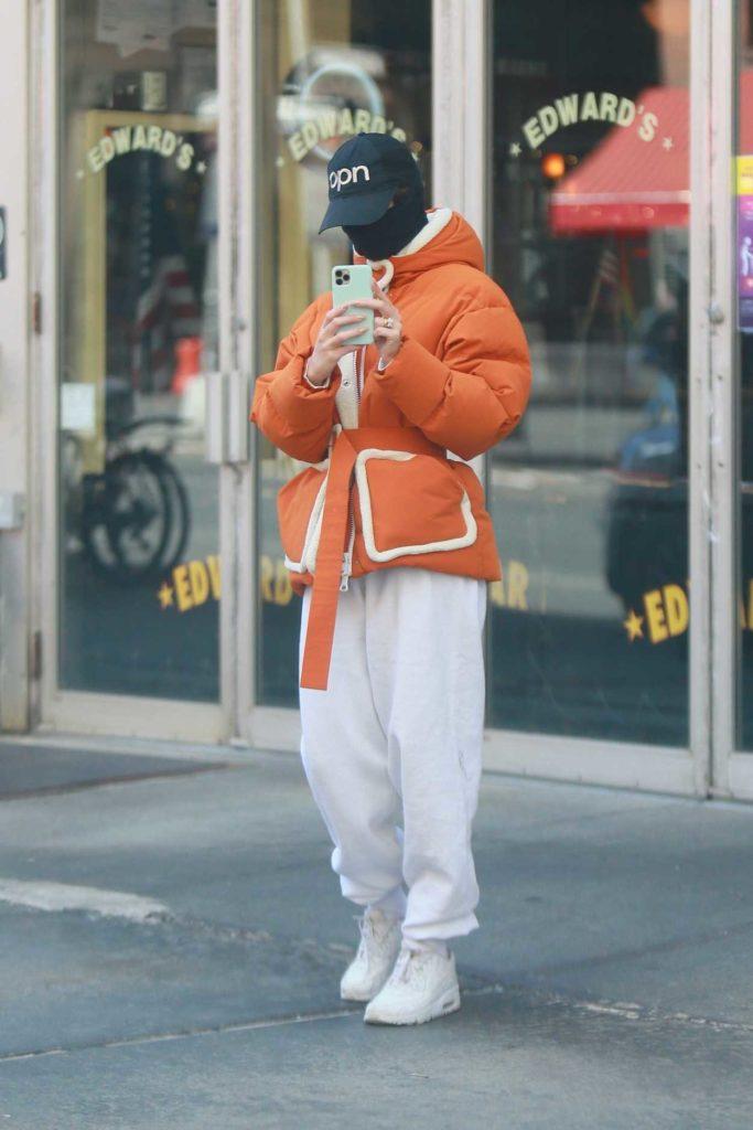 Emily Ratajkowski in an Orange Jacket