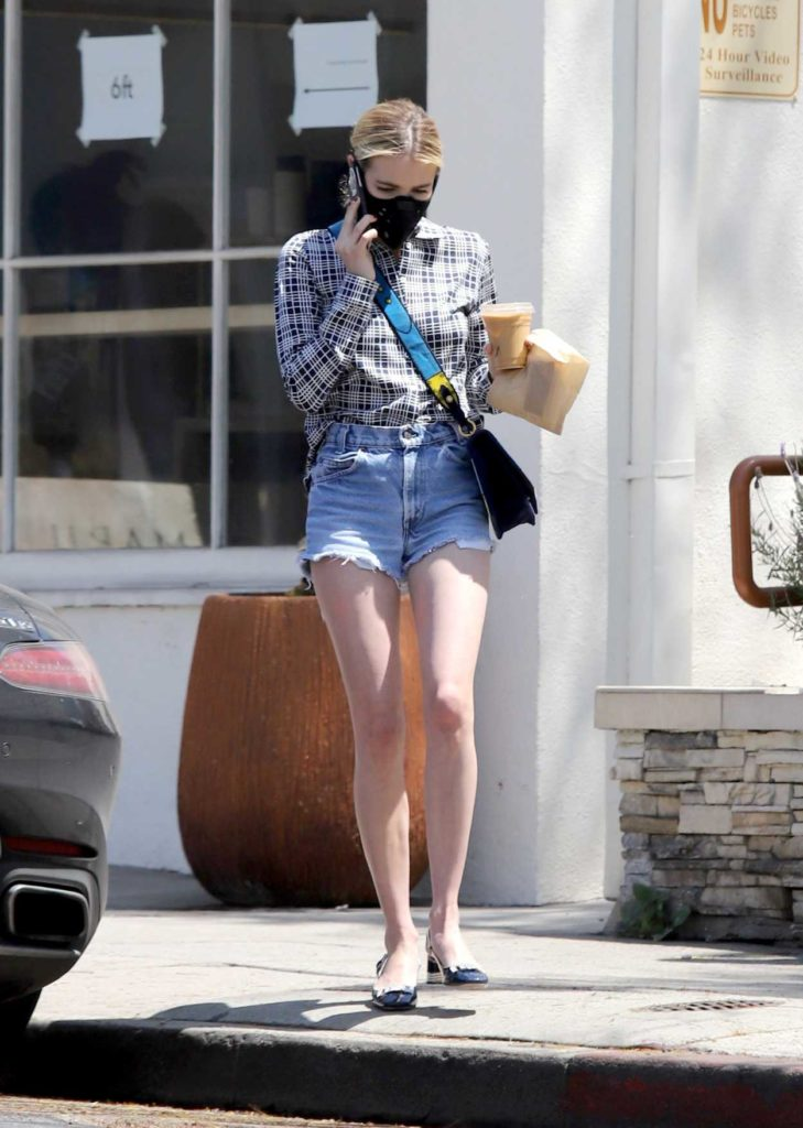 Emma Roberts in a Black Face Mask