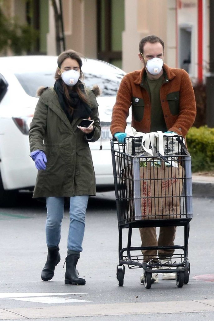 Lily Collins in a Purple Medical Gloves