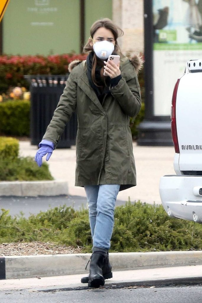 Lily Collins in a Purple Medical Gloves Leaves