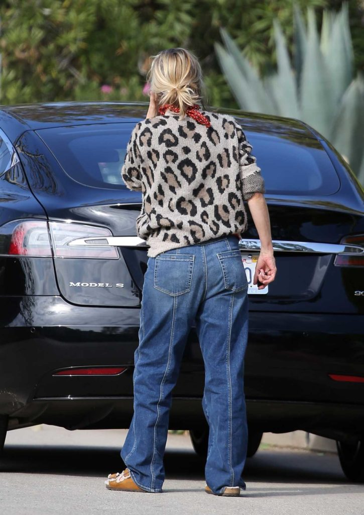 Michelle Pfeiffer in an Animal Print Sweater