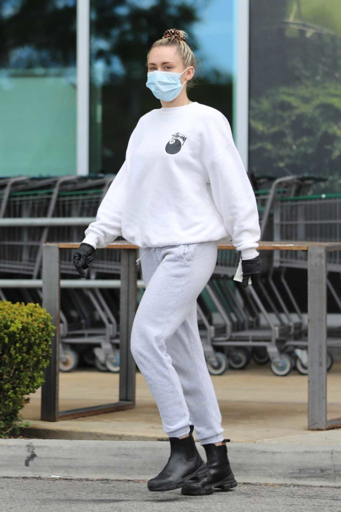 Miley Cyrus in a Surgical Face Mask