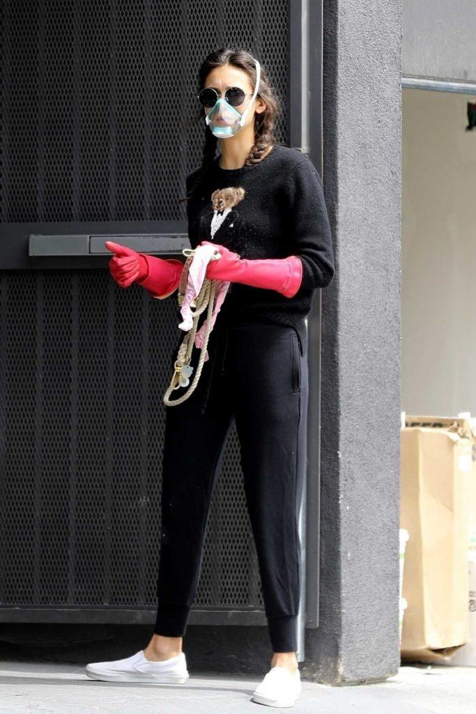Nina Dobrev in a Face Mask