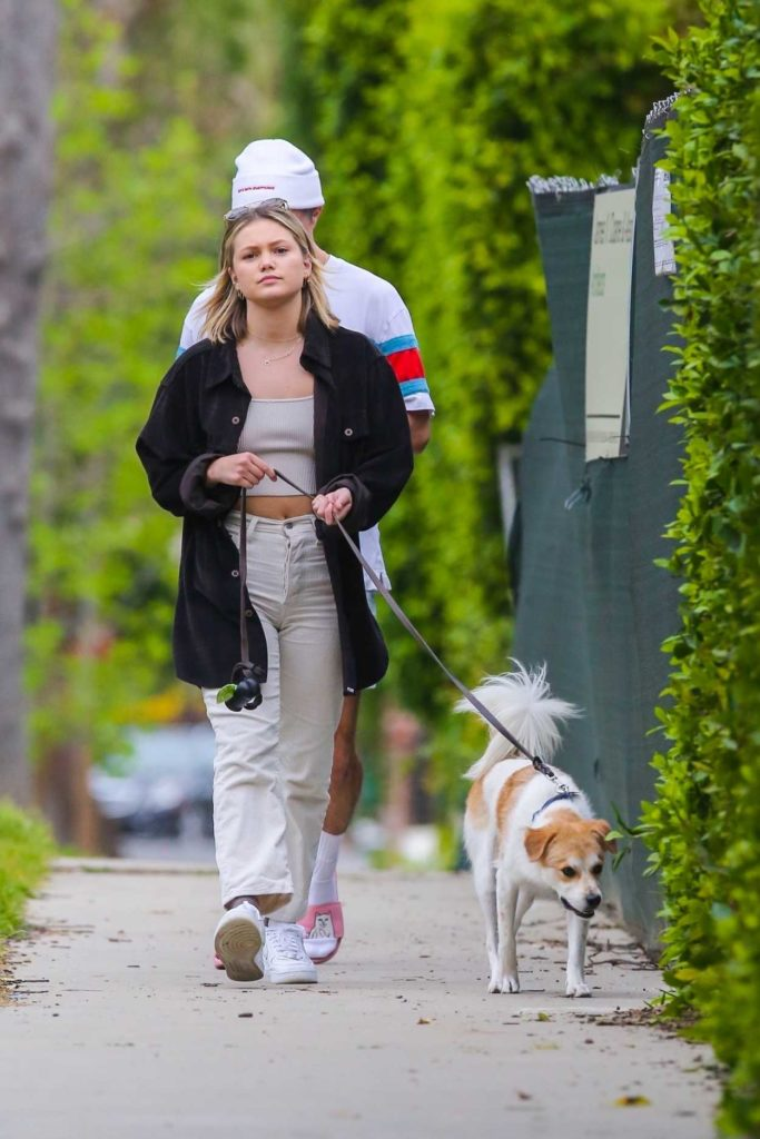 Olivia Holt in a White Sneakers