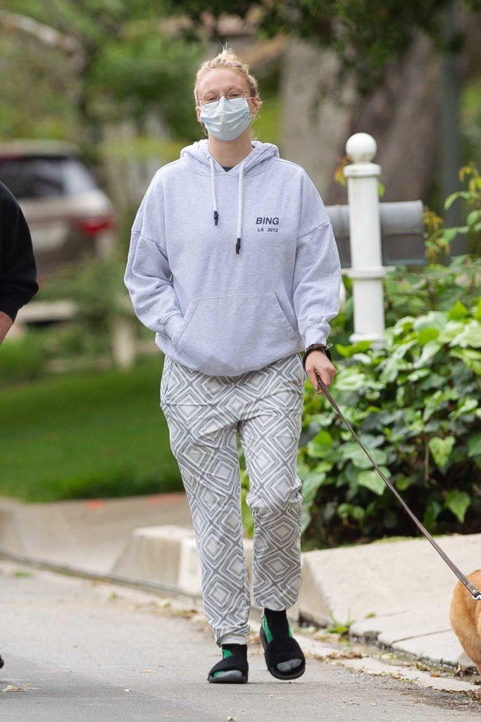 Sophie Turner in a Gray Hoody