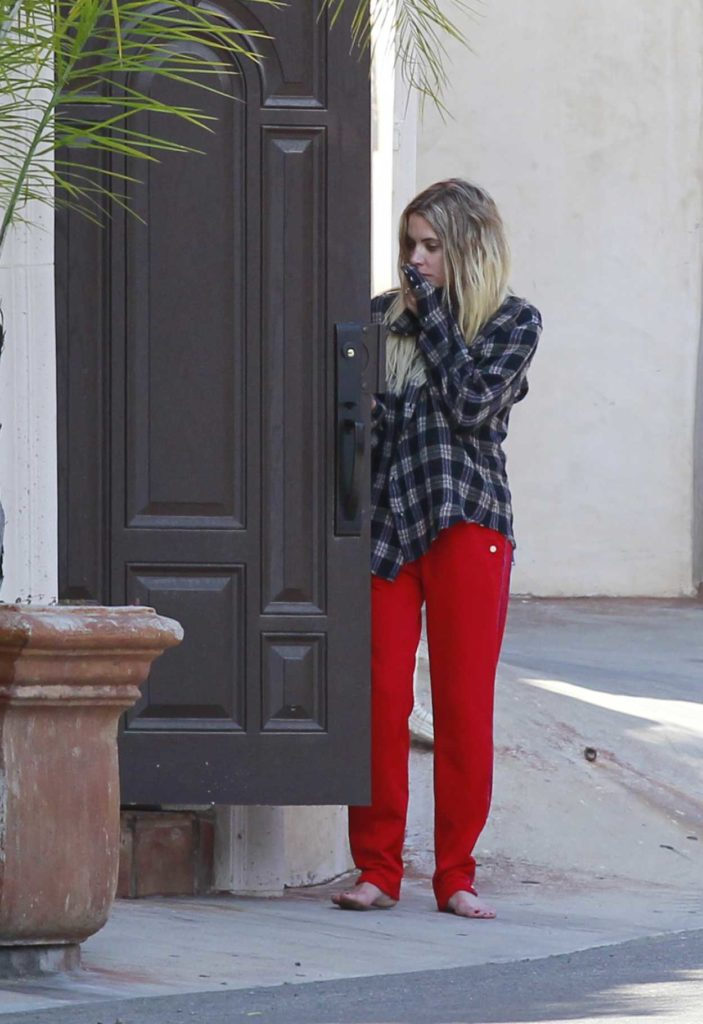 Ashley Benson in a Red Track Pants