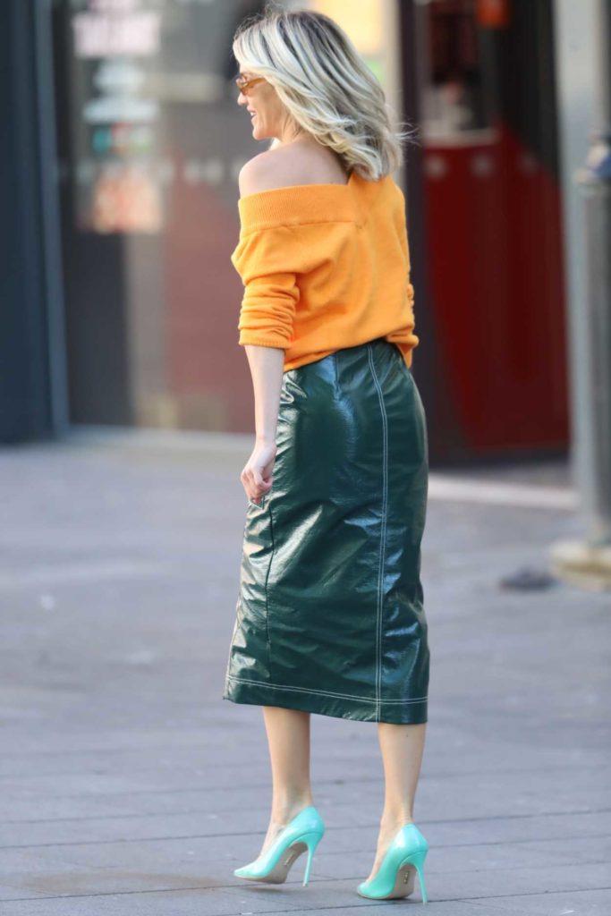Ashley Roberts in an Orange Top