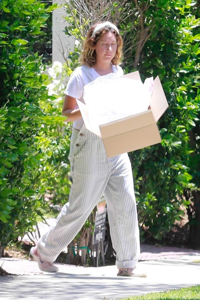 Ashley Tisdale in a Striped Coveralls