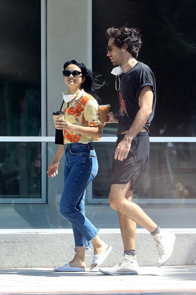 Camila Mendes in a White Flip-Flops