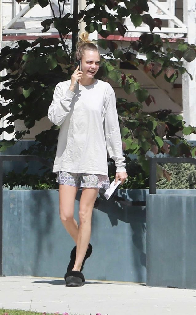 Cara Delevingne in a White Long Sleeves T-Shirt