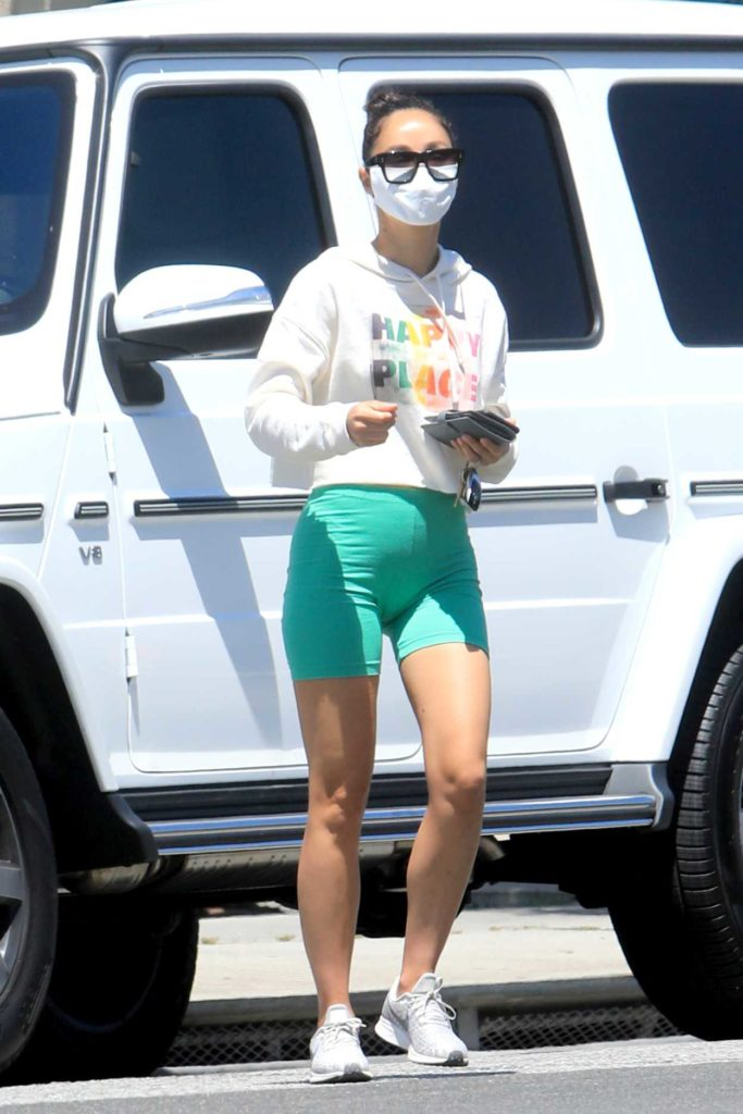Cara Santana in a Green Spandex Shorts