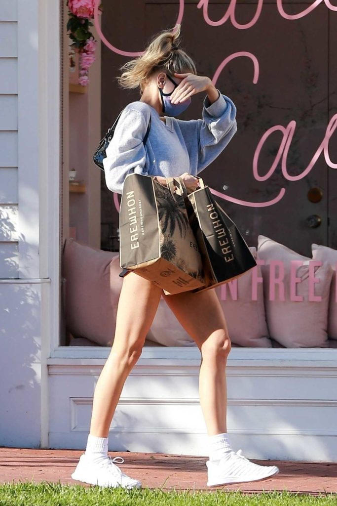 Charlotte McKinney in a White Sneakers