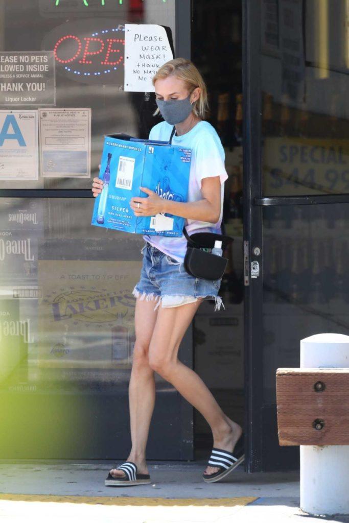 Diane Kruger in a Gray Face Mask