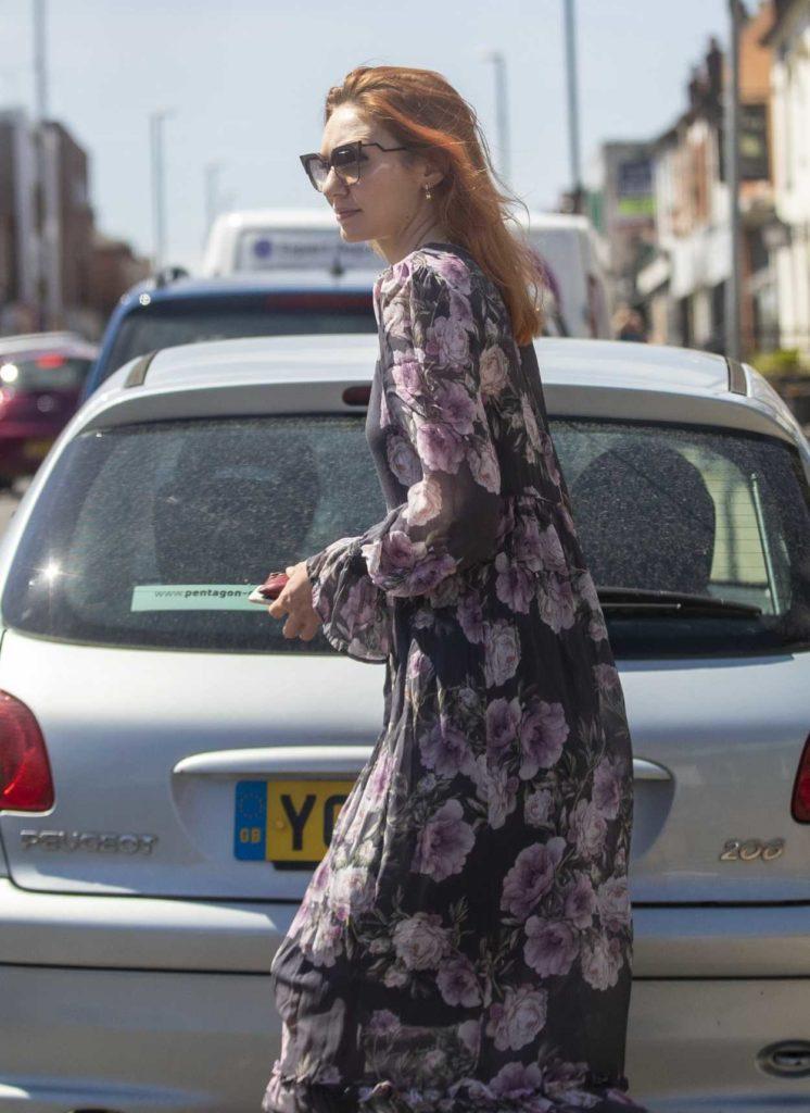 Eleanor Tomlinson in a Black Floral Dress