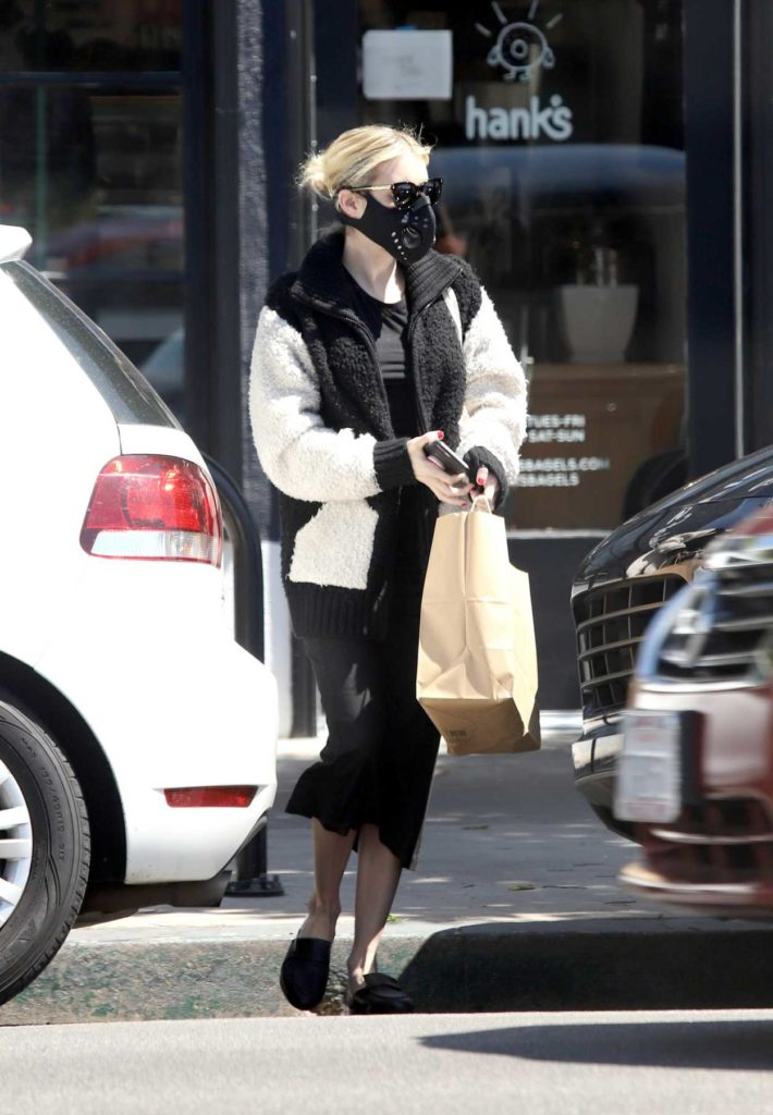 Emma Roberts in a Black Protective Mask