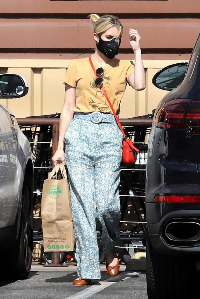 Emma Roberts in a Yellow Tee