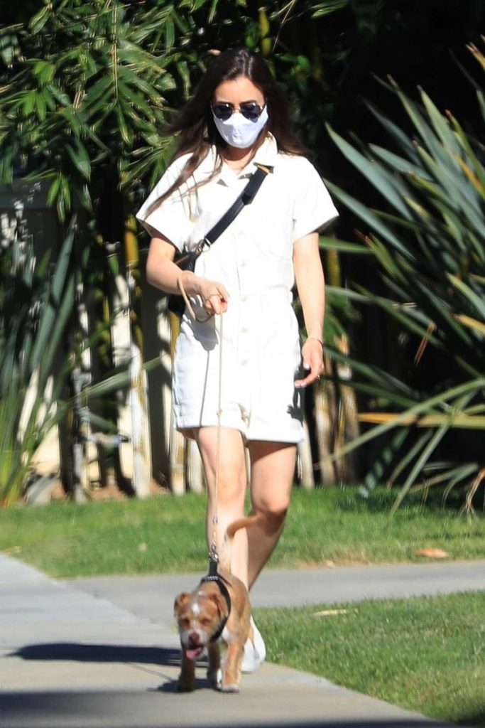 Lily Collins in a Protective Mask