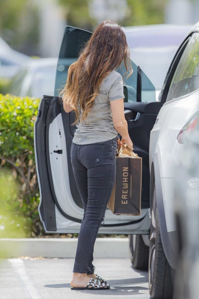 Megan Fox in a Black Ripped Jeans