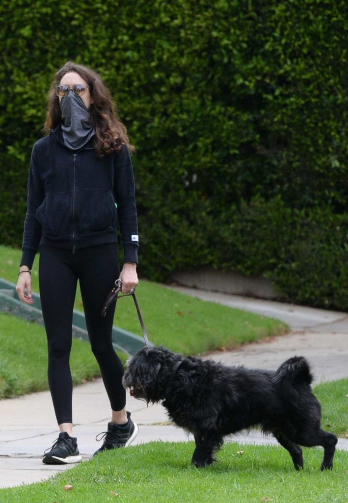 Troian Bellisario in Black Leggings