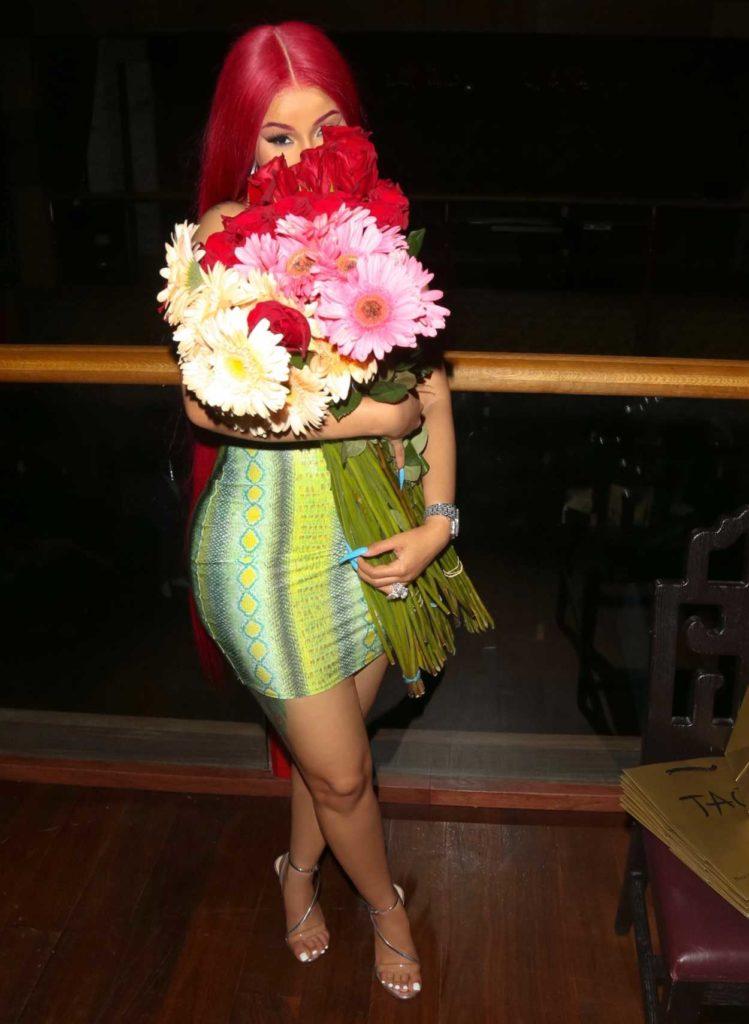 Cardi B in a Short Green Snakeskin Print Dress