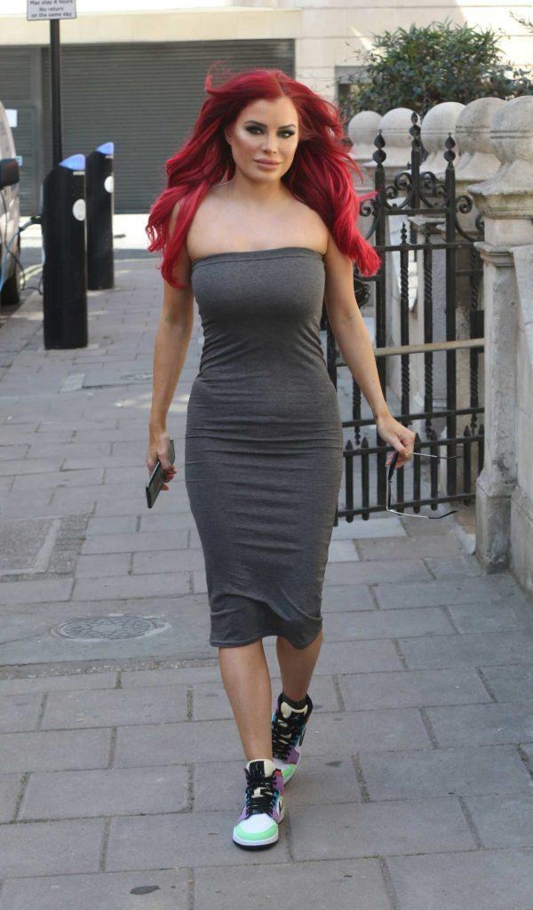 Carla Howe in a Grey Strapless Dress