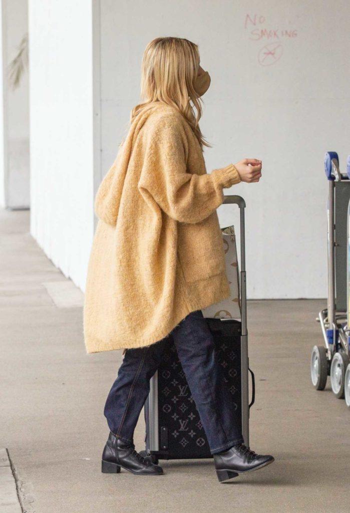 Emma Roberts in a Beige Cardigan
