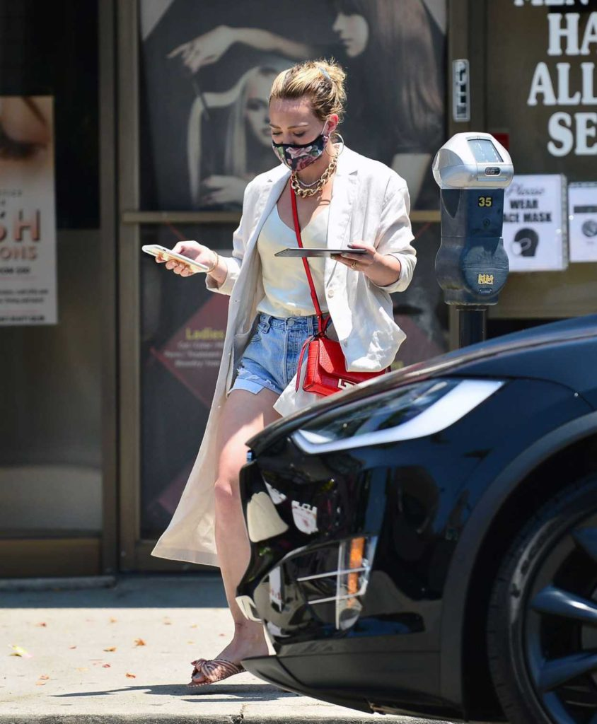 Hilary Duff in a Beige Trench Coat