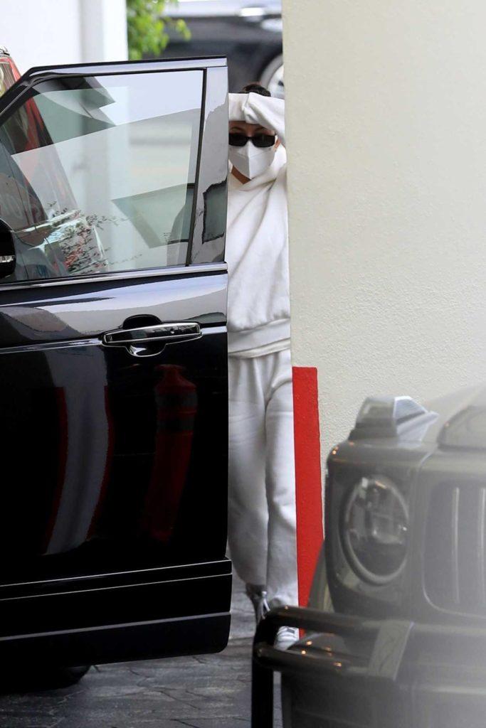 Kourtney Kardashian in a Protective Mask