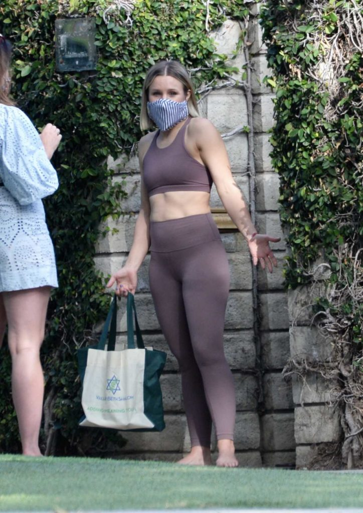 Kristen Bell in a Purple Workout Clothes
