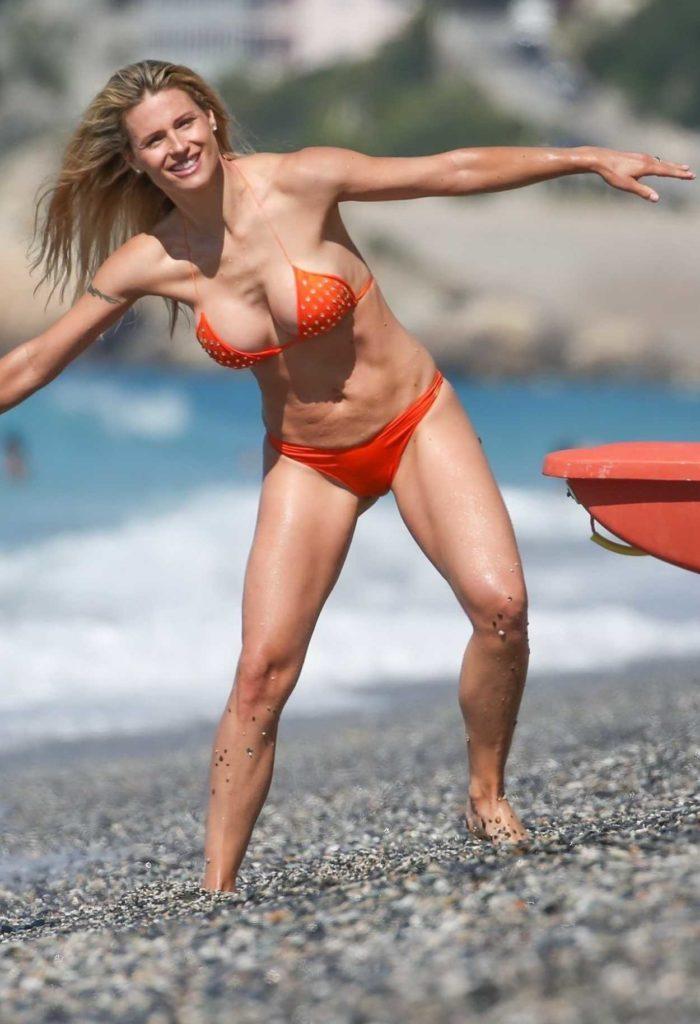 Michelle Hunziker in an Orange Bikini