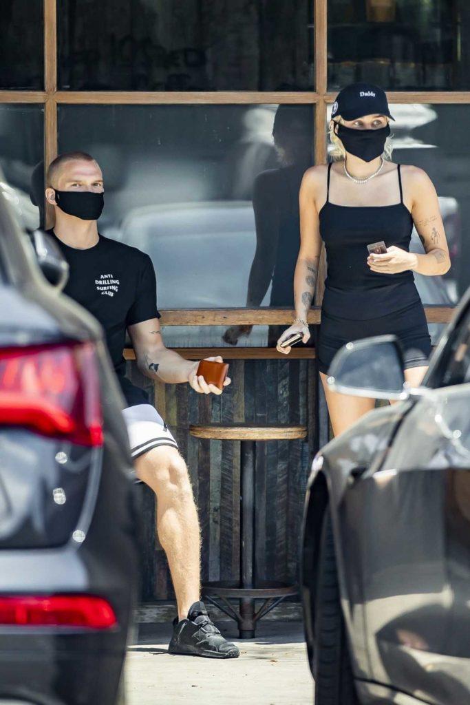 Miley Cyrus in a Black Cap