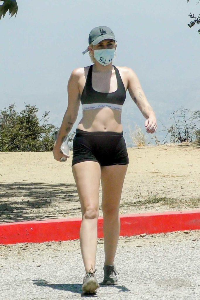 Miley Cyrus in a Black Sports Bra