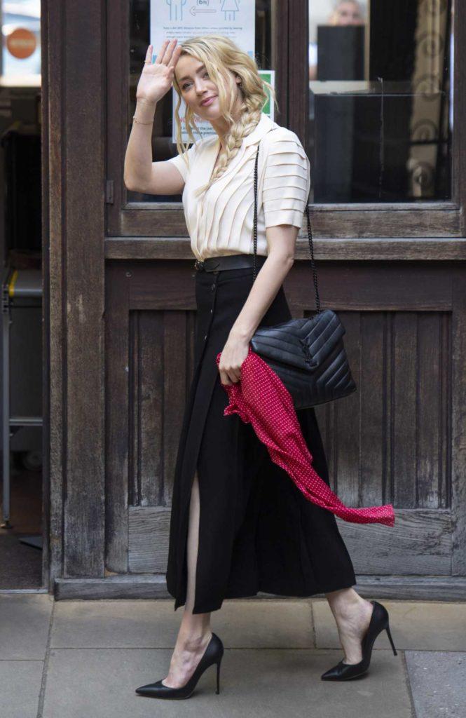 Amber Heard in a Beige Blouse