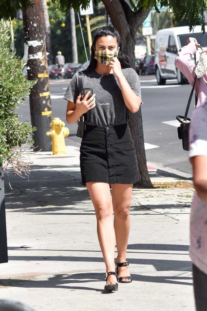Camila Mendes in a Black Skirt