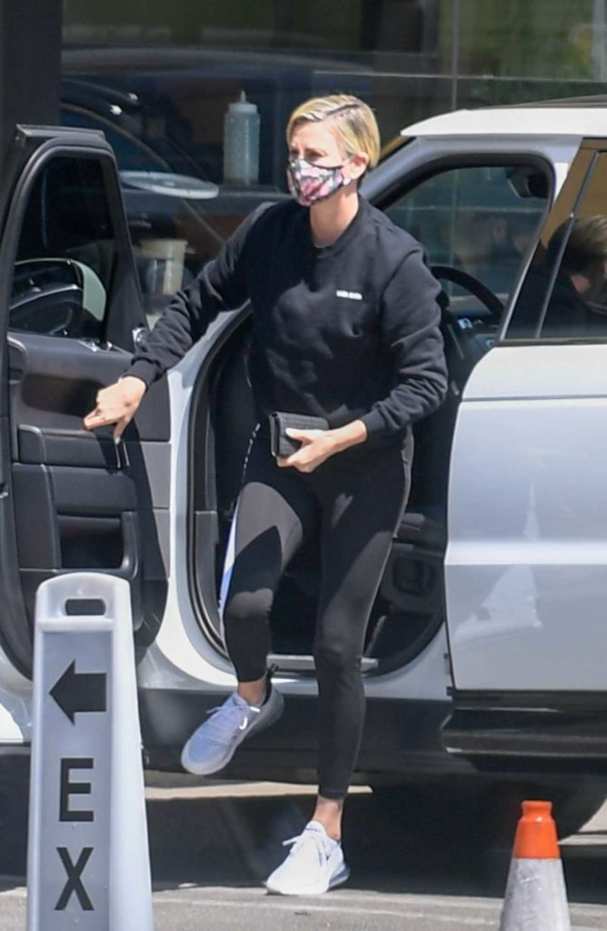 Charlize Theron in a Floral Protective Mask