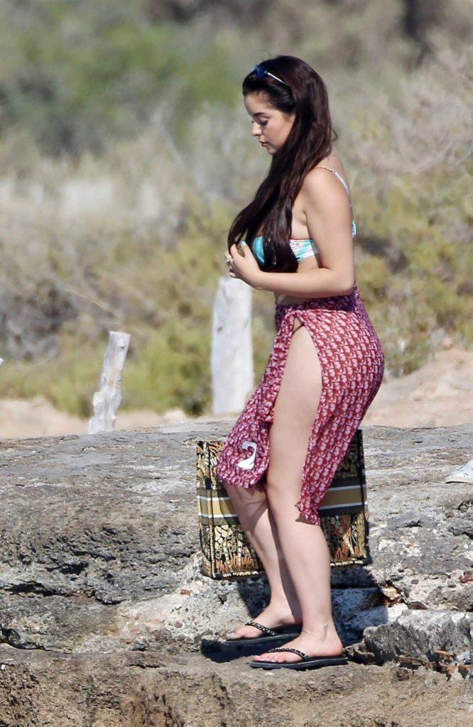 Demi Rose in a Black Flip-Flops