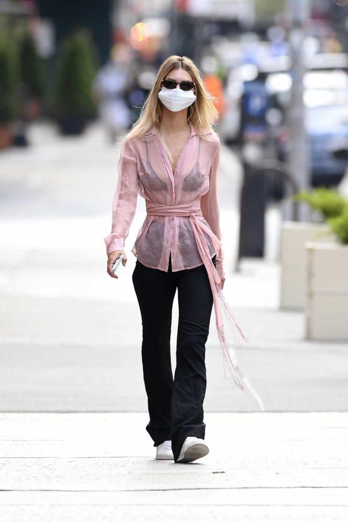 Emily Ratajkowski in a Pink Blouse