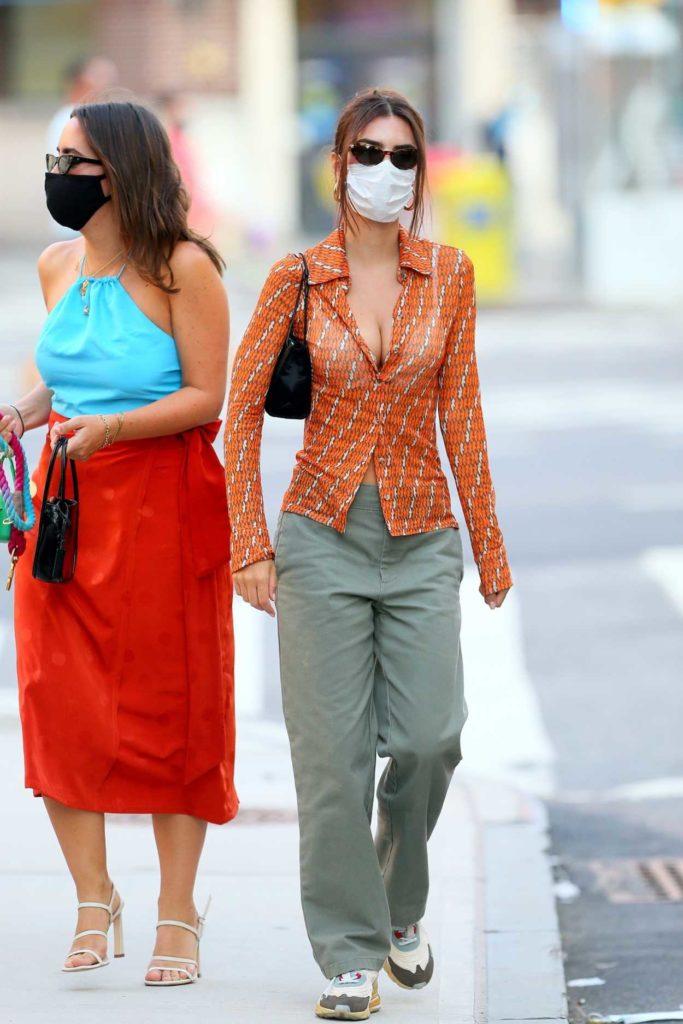 Emily Ratajkowski in an Orange Blouse