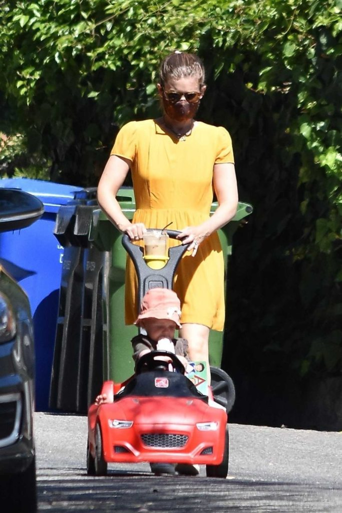 Kate Mara in a Yellow Dress