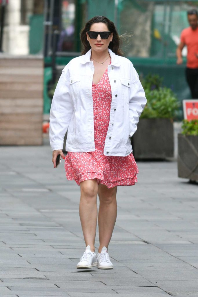 Kelly Brook in a White Denim Jacket