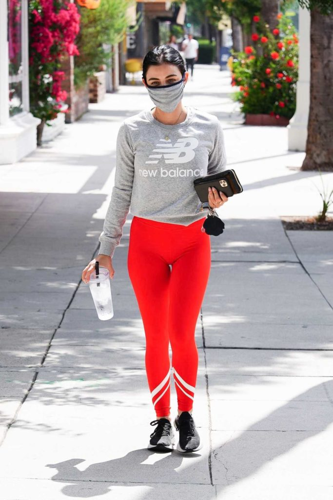 Lucy Hale in a Red Leggings