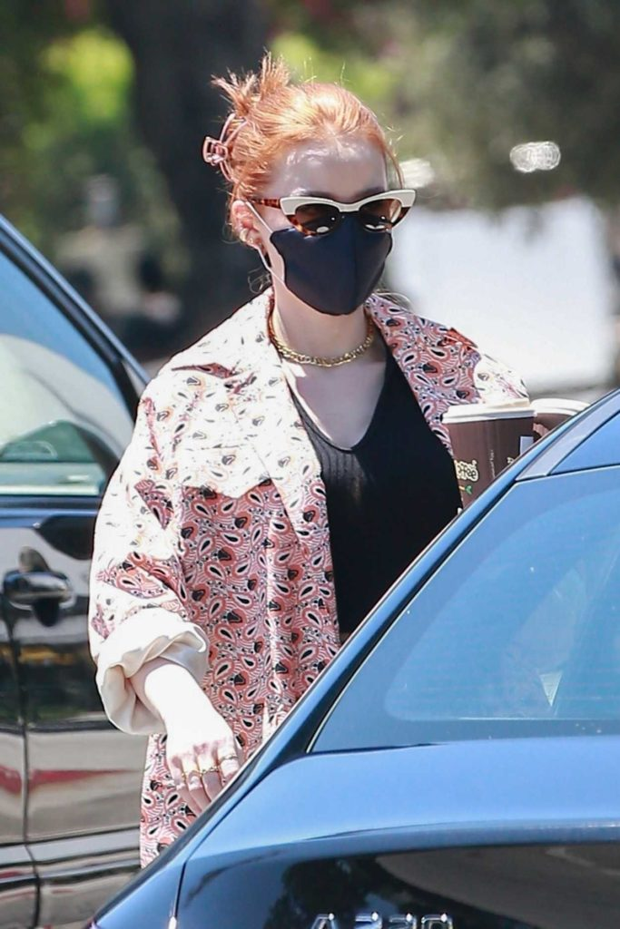 Madelaine Petsch in a Black Protective Mask
