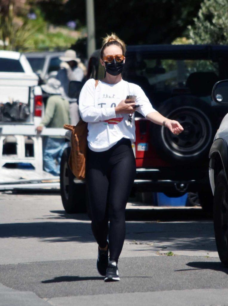 Olivia Wilde in a Black Leggings
