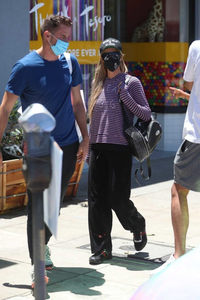 Paris Hilton in a Black Protective Mask