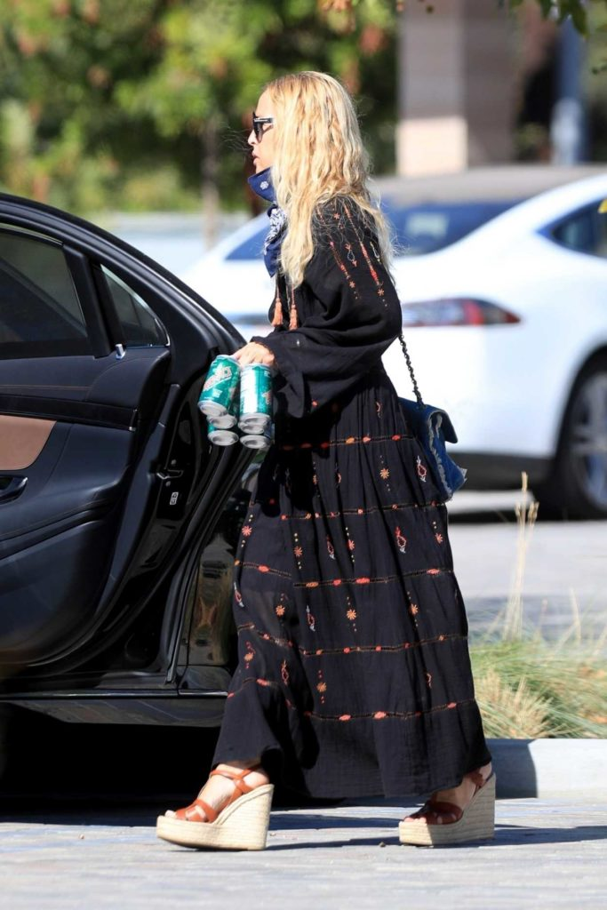 Rachel Zoe in a Black Dress