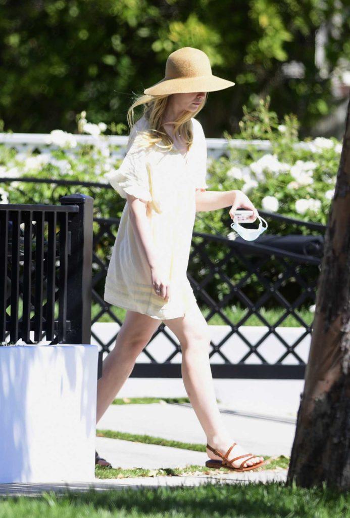 Elle Fanning in a Beige Hat