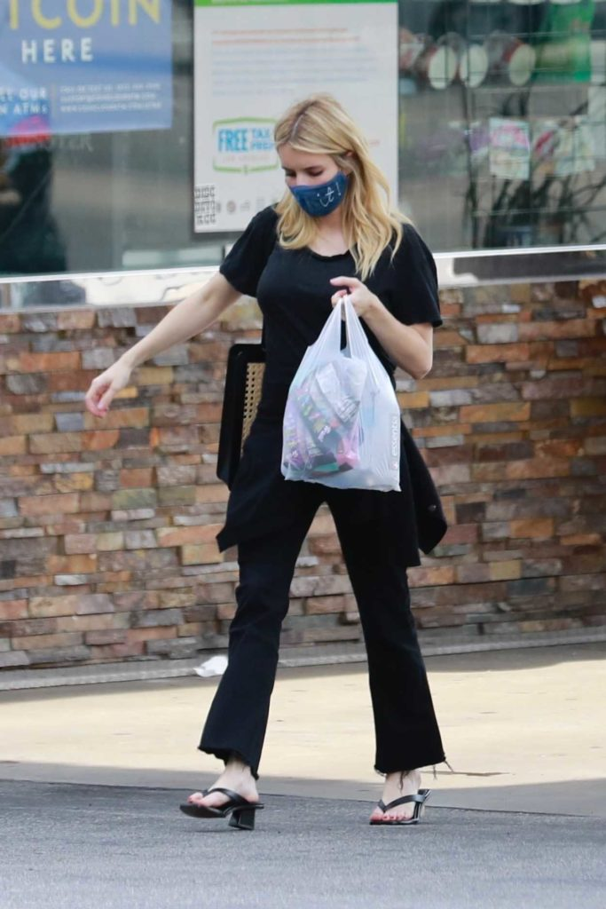 Emma Roberts in a Protective Mask