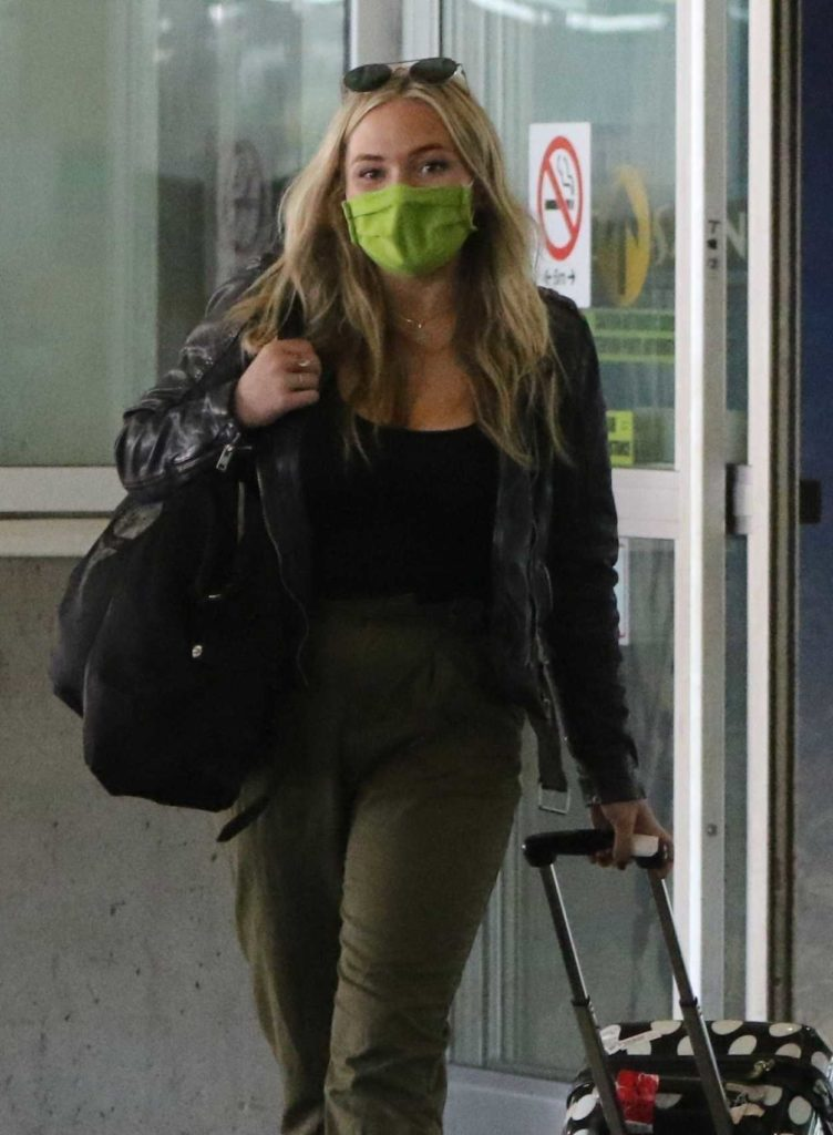 Natalie Alyn Lind in a Green Protective Mask