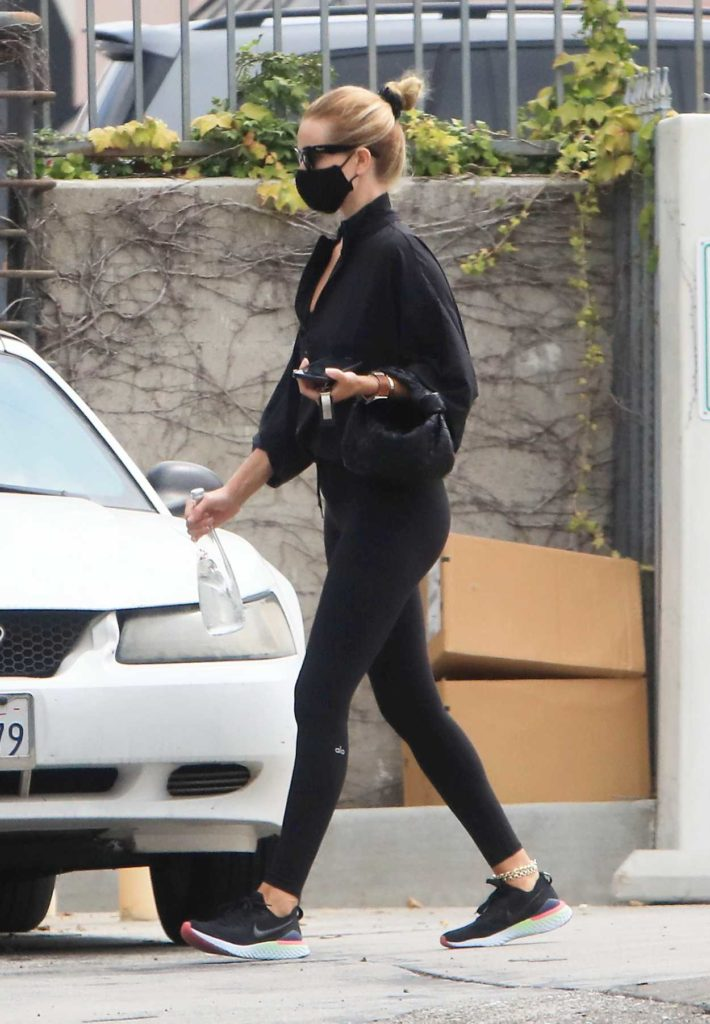 Rosie Huntington-Whiteley in a Black Protective Mask